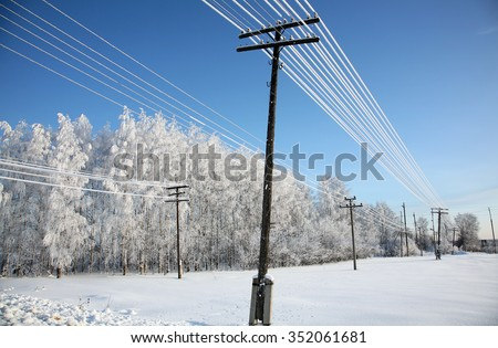 snow on electric wires - stock photo