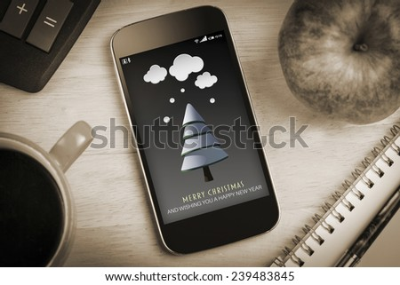 Snow on fir tree against overhead of smartphone screen - stock photo