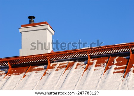 snow on the roof at winter - stock photo
