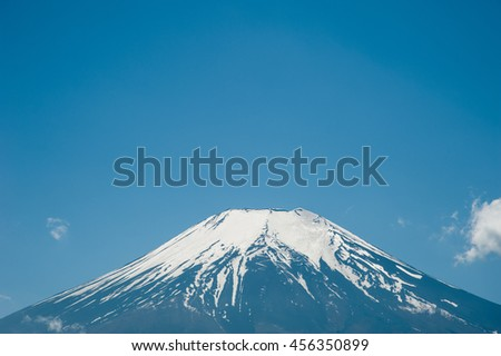 Snow on top Mountain Fuji with blue sky in winter at Kawaguchiko Lake, Japan. - stock photo