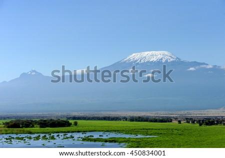 Snow on top of Mount Kilimanjaro in Amboseli - stock photo
