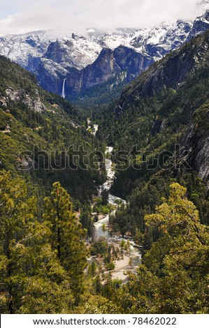 Snow on top of the mountain melts off and falls off the mountain as a water fall as it then transforms into a river and stream going into the forest. Yosemite national Park, California. - stock photo