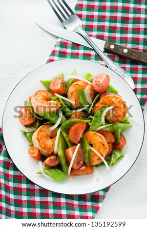 Snow peas and tomato salad with shrimps (prawns), vertical - stock photo
