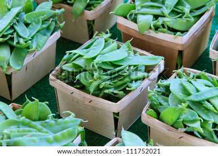 Snow peas in baskets at market - stock photo