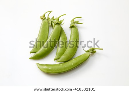 Snow peas isolated over white background