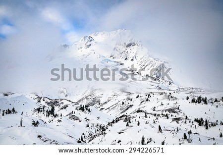Snow Peek at Mount Hood - stock photo