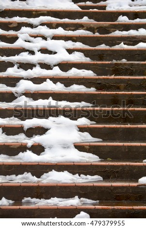 Snow piled up on stairs