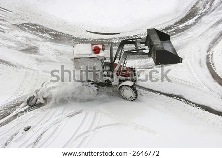 Snow Plow on small city road intersection - stock photo