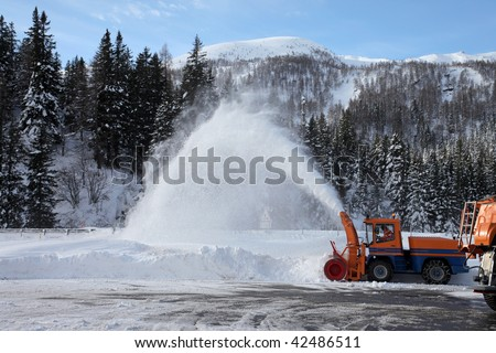 snow plow removing snow from the street - stock photo