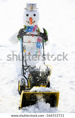 Snow removal - happy snowman snow removal, winter fun - stock photo