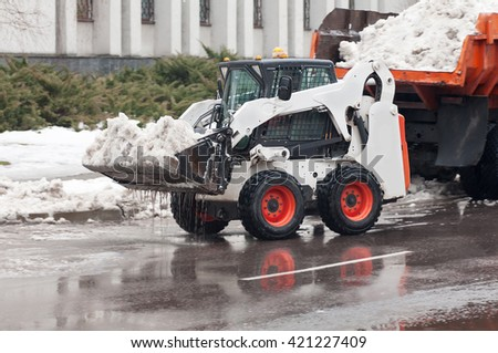 snow removal on the street - stock photo