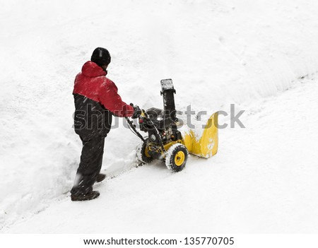 snow removal on the streets after a snowfall - stock photo