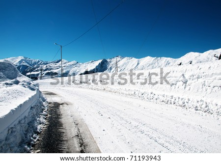 Snow road on the winter day - stock photo