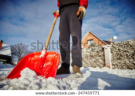 snow shovel cleans sidewalks in winter. Winter time.  - stock photo