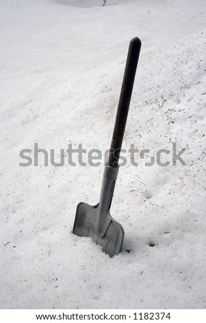Snow shovel in the snow - stock photo