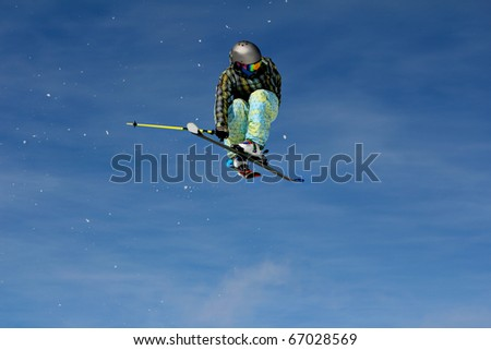 Snow skier freestyle air jump - stock photo
