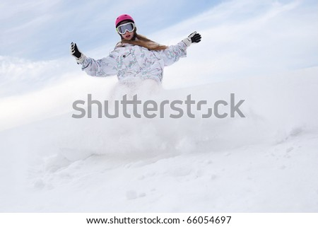 Snow splashes from girl rider snowboard - stock photo
