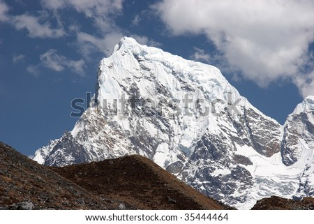 Snow summit of Cholatse mountain, Himalaya
