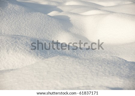 Snow surface in evening light - stock photo