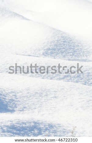 snow texture with some soft shades on it - stock photo