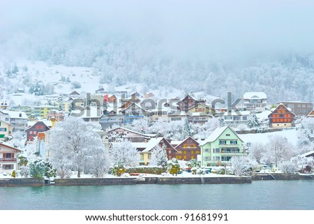 snow village around the luzern lake - stock photo