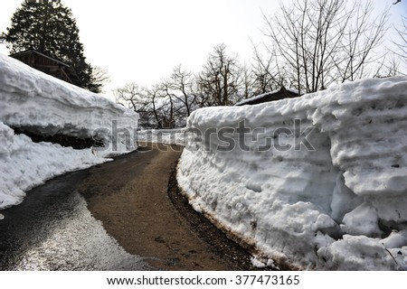 Snow wall near the road in Japan - stock photo