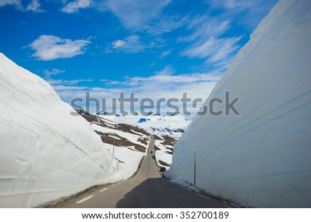 snow walls around a mountain road at the Norway - stock photo
