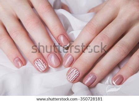 Snow White manicure on female hands. Winter nail design.