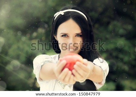 Snow White princess with the famous red apple.  - stock photo