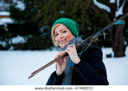 Snow winter woman with ski walking the landscape - stock photo