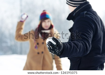 Snowball fight! - stock photo