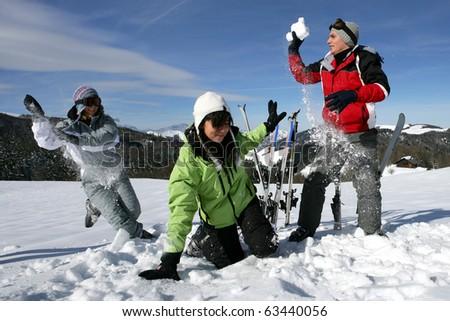 Snowball fight between friends - stock photo