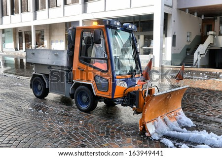 snowblower removes snow from the sidewalk - stock photo