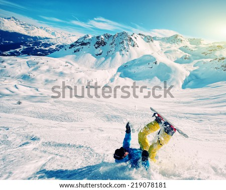 Snowboard crash - stock photo