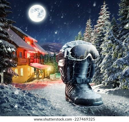 Snowboard equipment in winter village - stock photo
