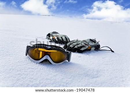 Snowboard equipment on white snow - stock photo