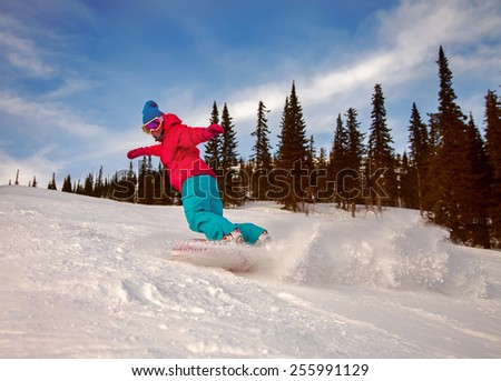 Snowboard freerider in the mountains - stock photo