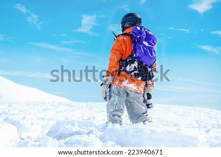 Snowboard freerider in the mountains with helmet - stock photo
