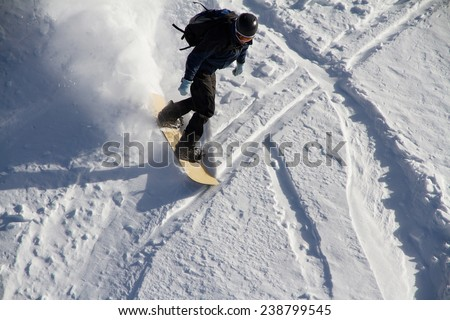 Snowboard freerider in the snowy mountains - stock photo