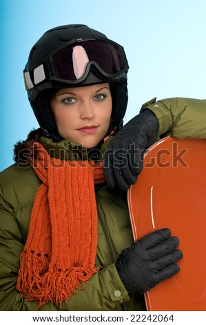 Snowboard girl in orange and green outfit on blue background