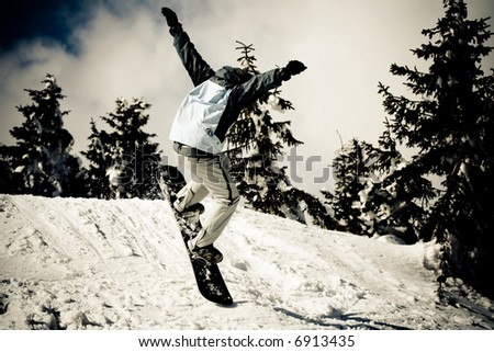 Snowboard in air. Winter sport lifestyle concept - stock photo