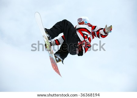 Snowboarder and a cloudy sky - stock photo