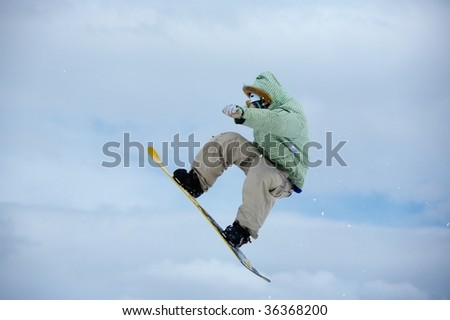 Snowboarder and a cloudy sky