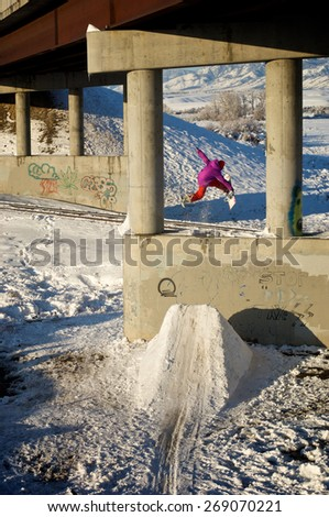 Snowboarder Catching Air  - stock photo