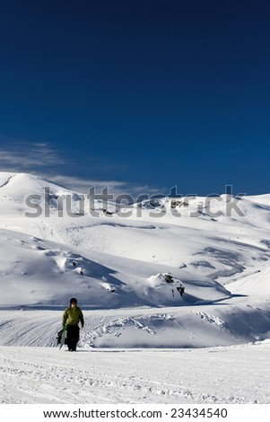 snowboarder climbing a slope - stock photo