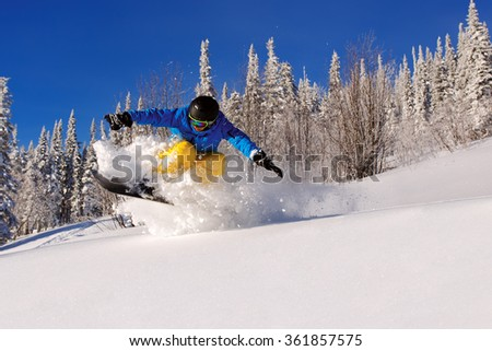 Snowboarder doing a toe side carve