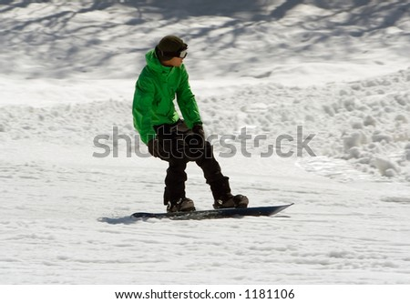 Snowboarder getting ready to jump - stock photo