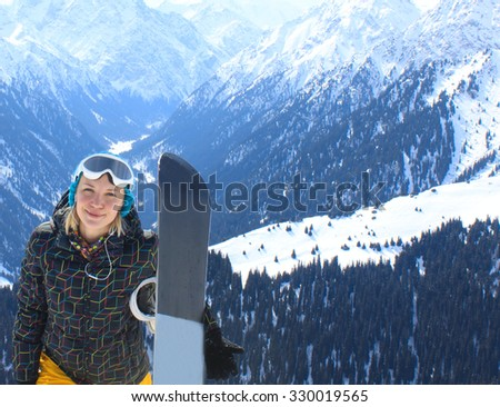 snowboarder girl standing hold snowboard