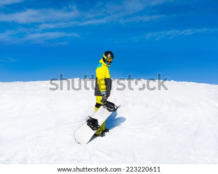 Snowboarder hold snowboard on top of hill, snow mountains snowboarding on slopes