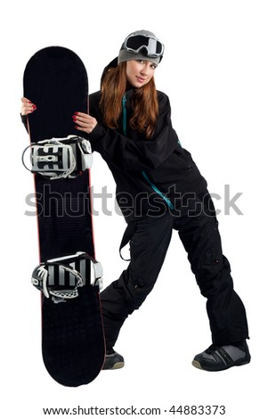 Snowboarder in a goggles holding his board - stock photo